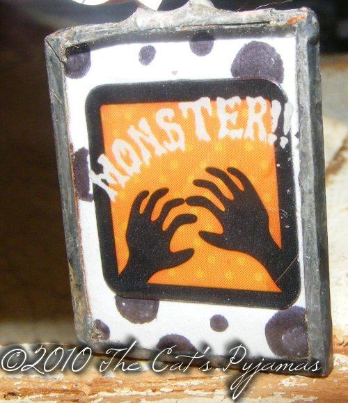 Monster hands pendant