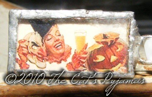 Vintage Halloween ad pendant