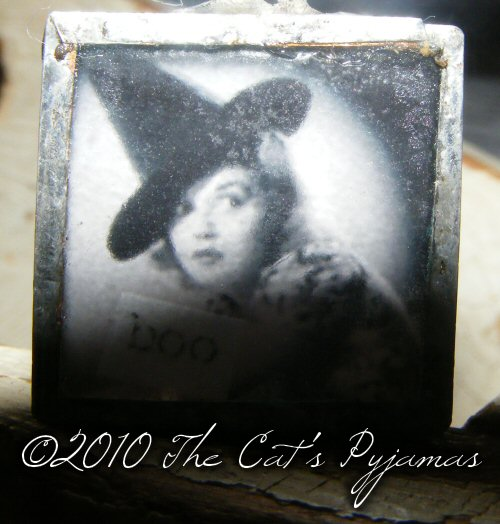 Vintage pinup witch pendant