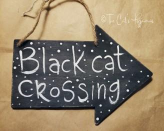 Black Cat Crossing Sign