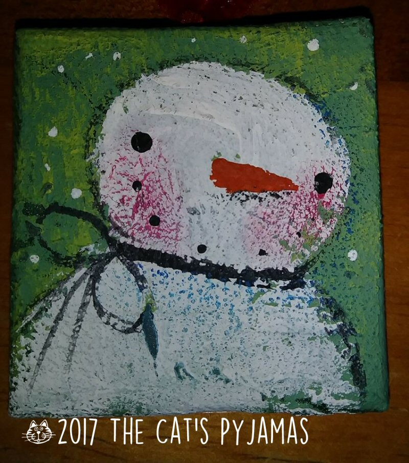 Snowman on green ornament