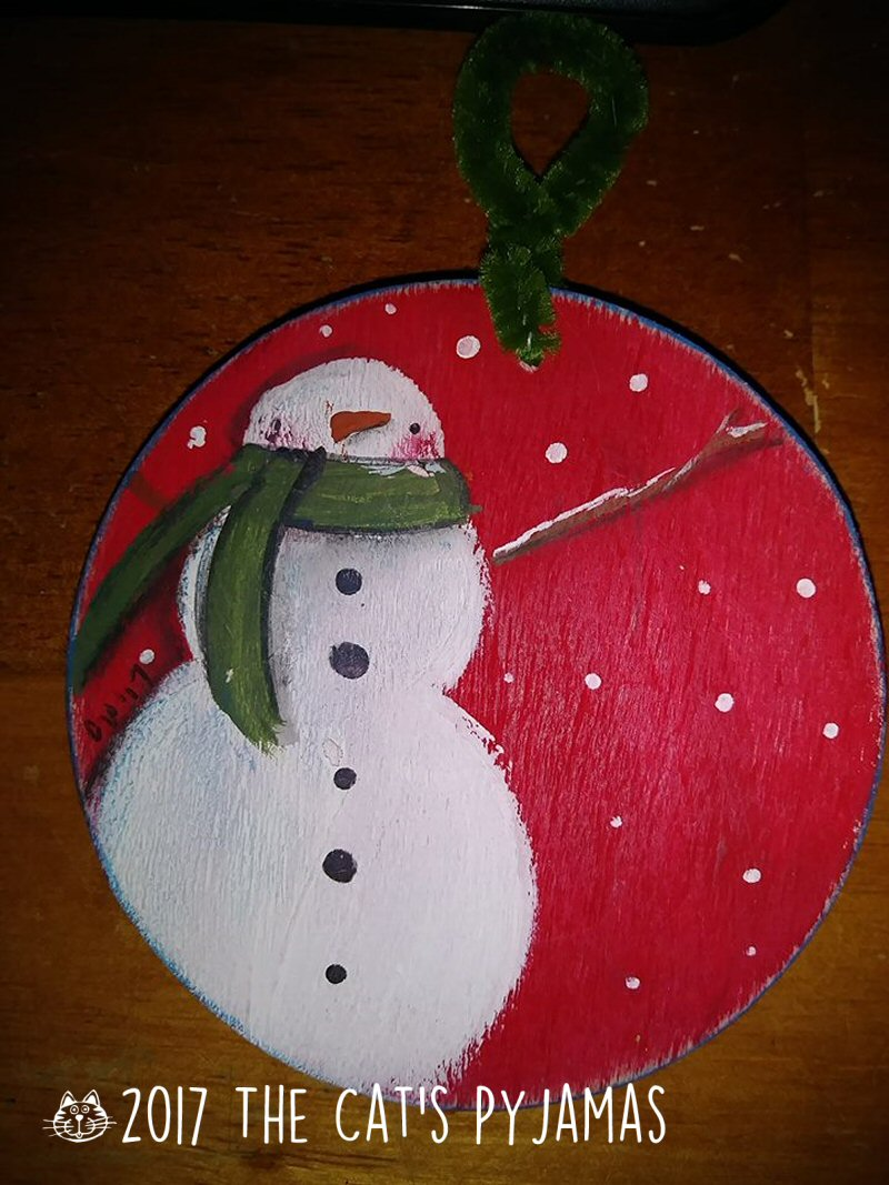 Snowman on red ornament