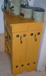 Primitive Mustard Cabinet